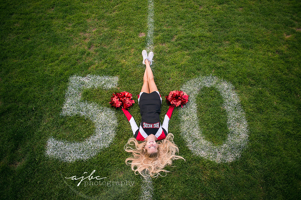 port huron high school senior girl photoshoot senior cheerleader photoshoot football field senior photos.jpg