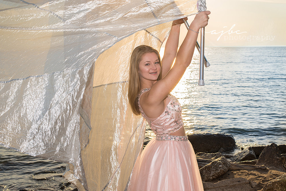 outdoor senior photoshoot port huron high school class of 2017 senior photoshoot color gaurd beauty prom dress photos on lake huron.jpg