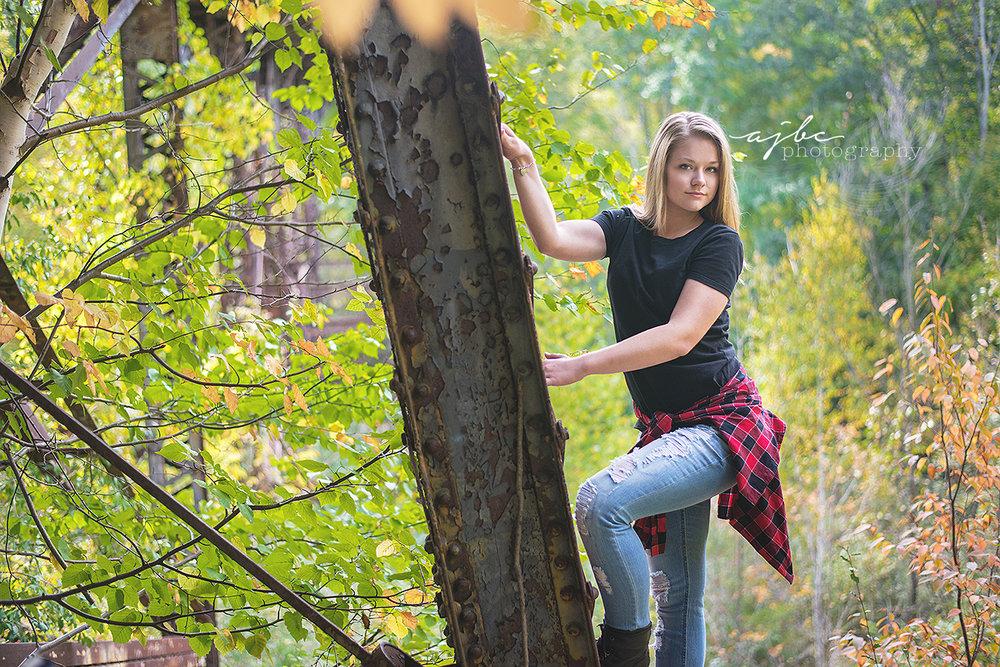 port huron michigan outdoor senior photographer outdoor beauty tom boy climbing trees fall colors senior beauty.jpg