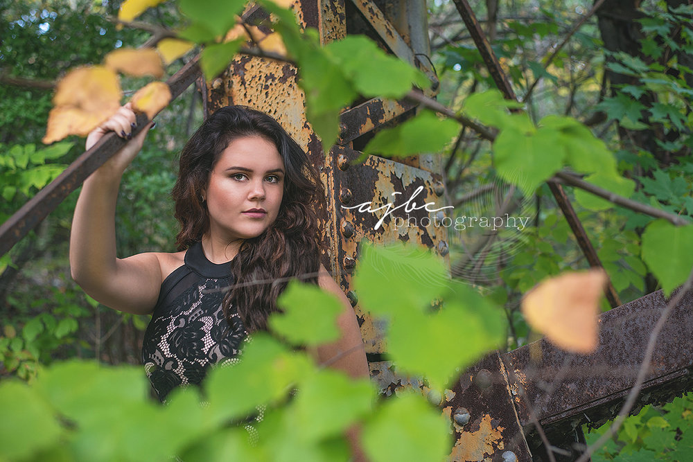 fall outdoor michigan high school senior photoshoot rustic senior shoot at the train tracks fall beauty.jpg