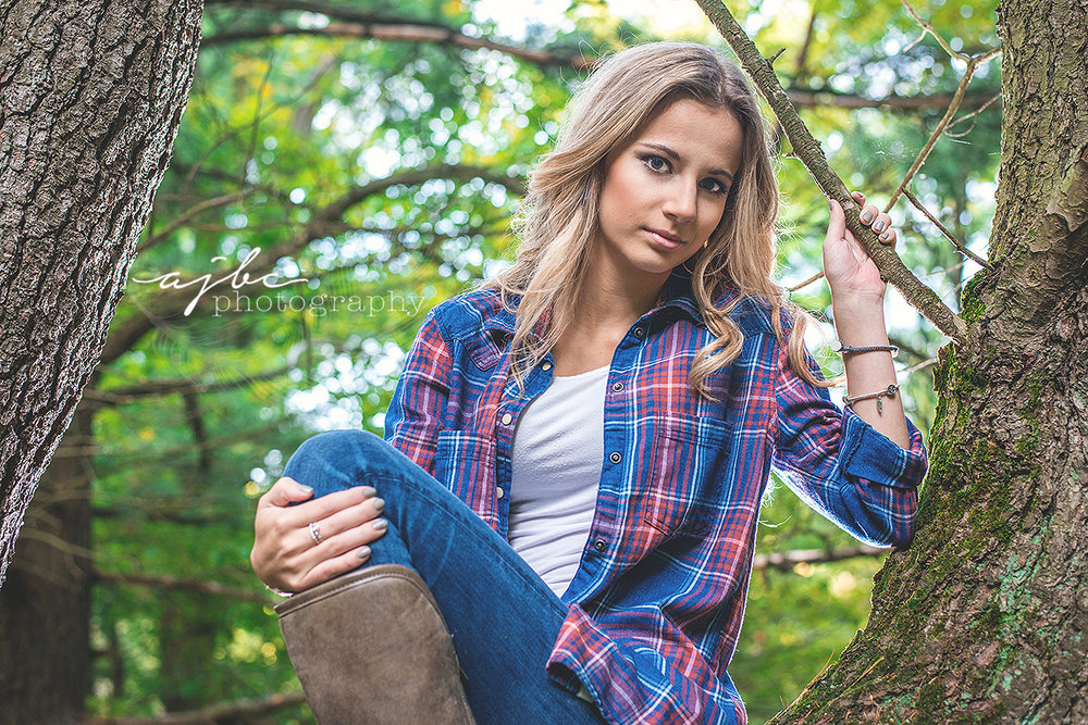 senior photoshoot in the woods country girl plaid shit cowboy boots class of 2017 senior girl senior beauty senior fashion.jpg