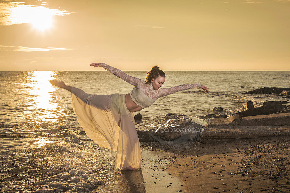 michigan lyrical dancer photographer professional dancer on lake huron sunrise photoshoot.jpg