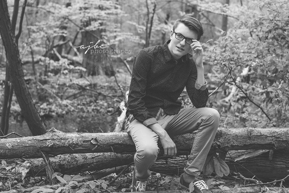 outdoor senior photshoot michigan in the woods photographer.jpg