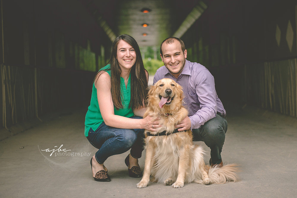 downtown port huron couple photoshoot michigan engagement photographer couple photos with dog love golden retriever.jpg