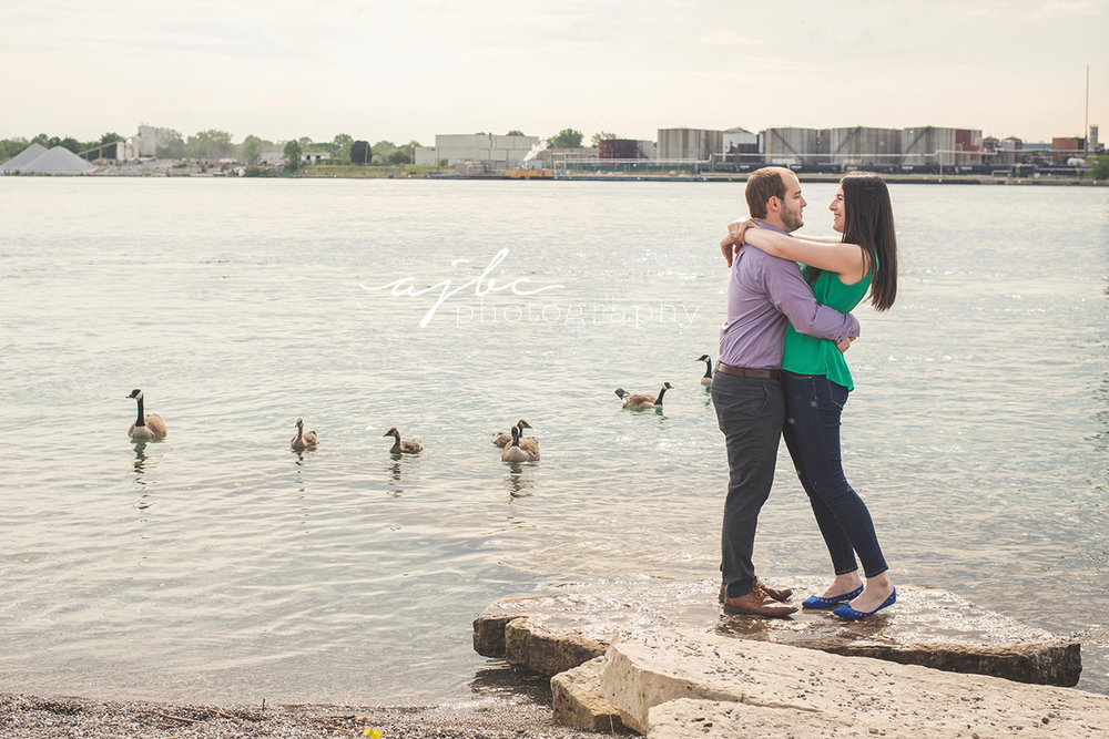 engagement session on lake huron michigan couple photographer.jpg