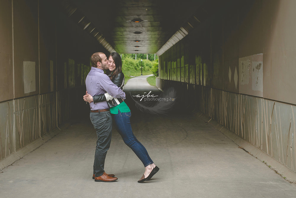 fun engagement photoshoot outdoor couple session michigan photographer love couples engagement blue water river walk.jpg