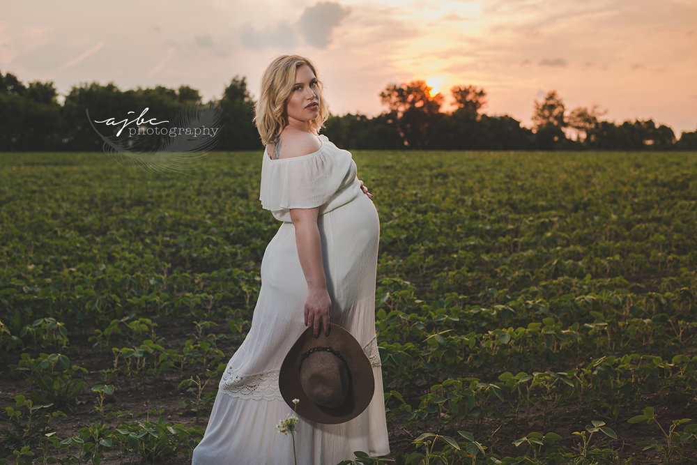 maternity session in a field sunset beauty.jpg