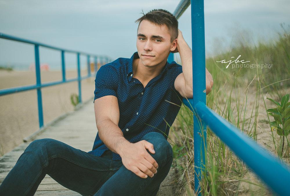 senior boy photoshoot on the beach.jpg