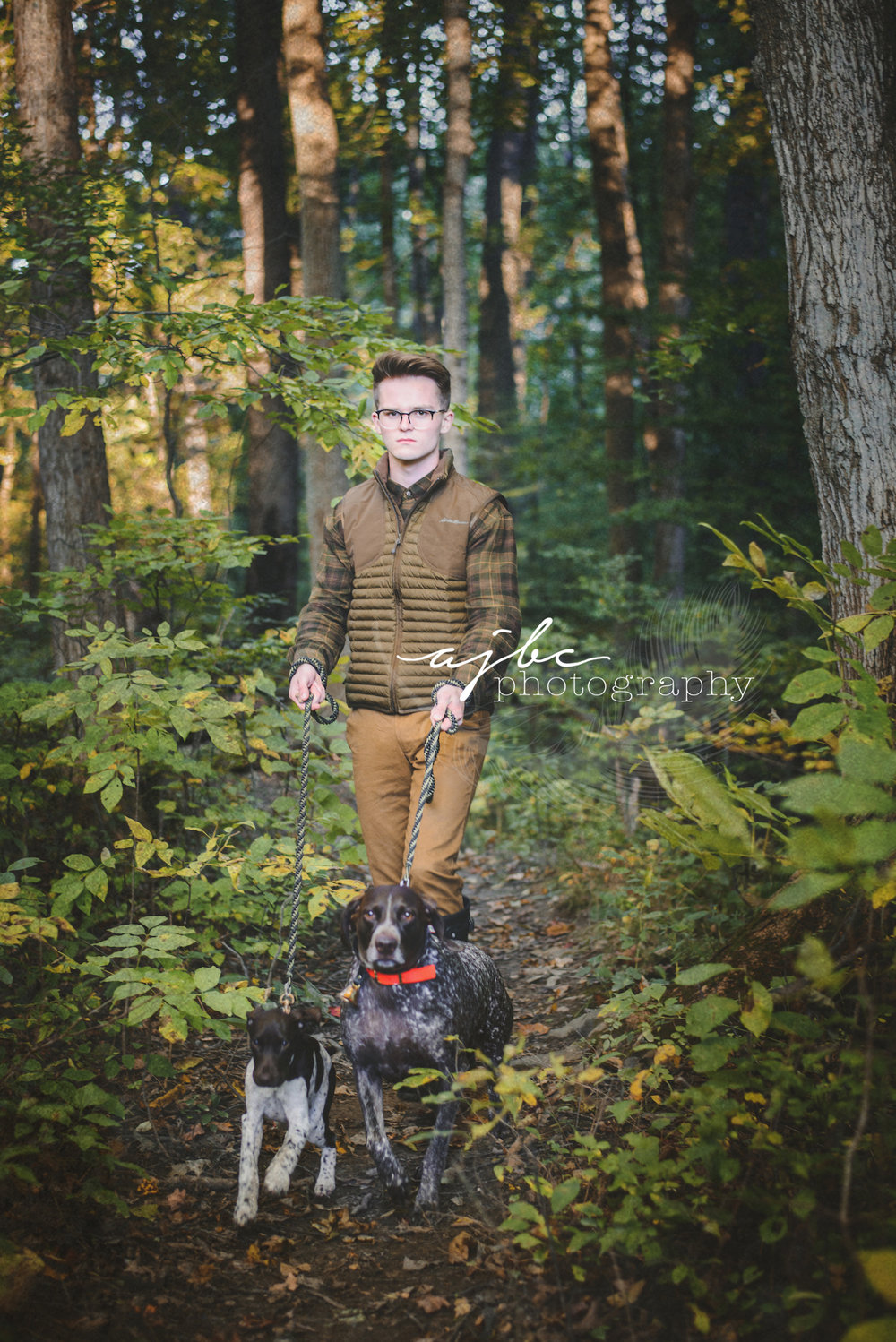 senior with dogs photography.jpg