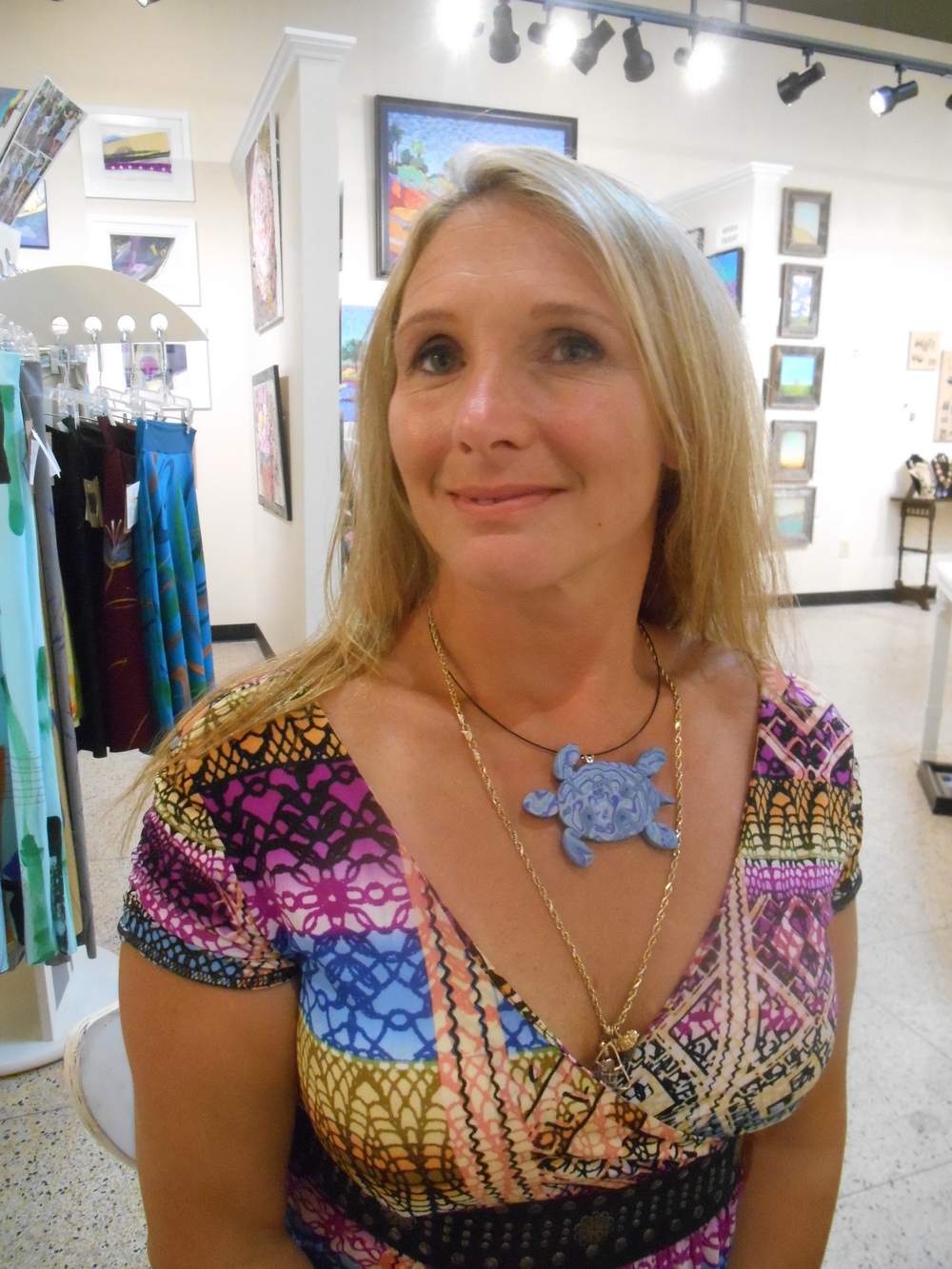 The lovely Carrie is modeling her incredibly unique turtle pendant!  This color scheme and pattern just make me want to swim in it!  Great creative piece!