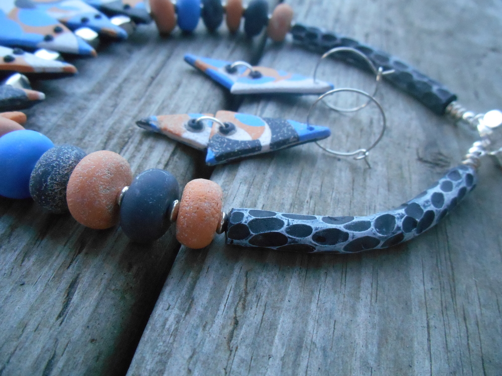 An up close of the little textured beads and the hand carved tube beads.  Such a fun wearable art set.  I hope you enjoyed watching me build the bones of my design!  Perhaps it sparked a new passion in you!