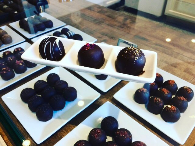 Our mouths are already watering thinking about these yummy chocolates from @plazapanache! Come see us at our pop up this Thursday from 5-8 pm at the best chocolatier in town!🤗🤗🤗