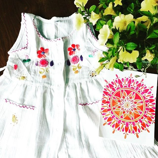 Hand embroidered baby dresses, fresh blooms + @catcoq print! SWOON! #handmade #ecuador