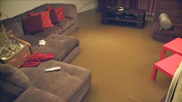 This is my living area. The brown color you see on the ground is NOT my carpet.. that's a foot of water.