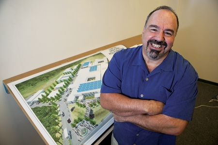 Jim Ansara with rendering of University Hospital in Mirebalais