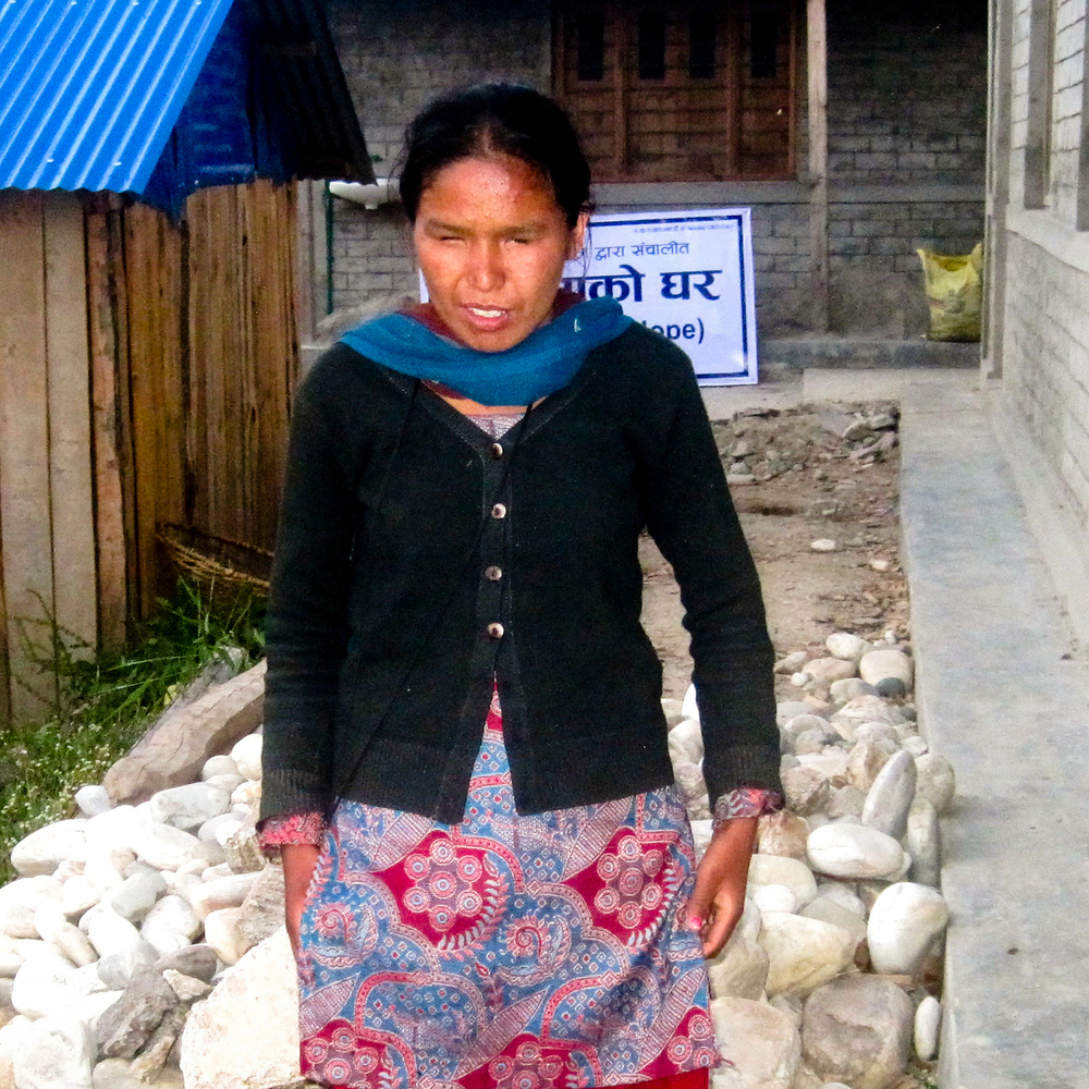 Satya Budha is eighteen years old and studies in grade seven. She was born blind. She is very excited about living in the new building and going to school.