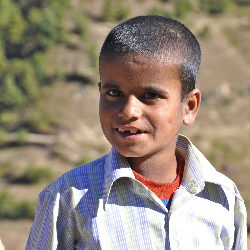 Dharmalal Pyakurel is eleven years old and studies in grade five. He has one younger brother. He was born blind, and his parents brought him to the Jumla Project for an education. Dharmalal likes to sing Nepali folk songs, and believe it or not, he also likes to run around with his friend Ganesh.