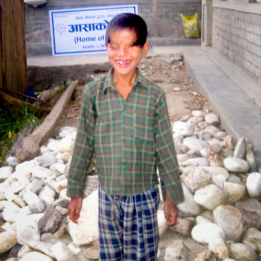 Janak Adhikari is ten years old and studies in grade five. He was born blind. Janak is the youngest of three children, and his family often went without food. He is grateful to God for the opportunity to live and study in the Jumla Project.