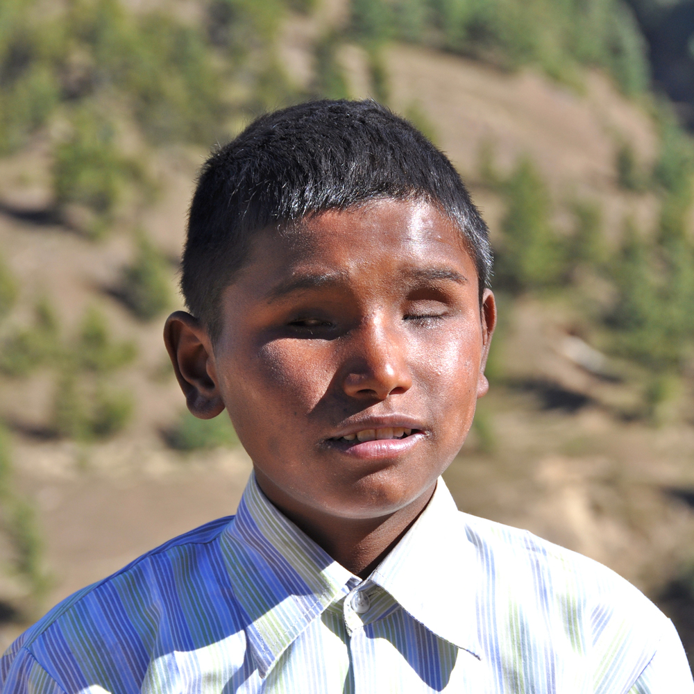 Laxman Bohara is fifteen years old and studies in grade six. He is from a family of six and was born blind. His parents brought him to the Jumla Project for an education. Laxman's favorite subject is math, and he eventually wants to be a teacher. He likes to play a Nepali percussion instrument called a maadal.