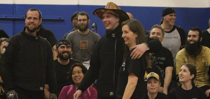 Longsword champion Dennis Lungqvist sporting the bronze cowboy hat, with Natasha Darce. Photo by Kelley Kotch.