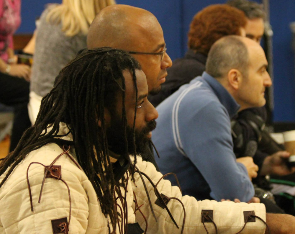 "Da'Mon Stith and Brian ""Tree"" Fischer watch the Messer Finals. Da'Mon, a Tuareg fighter, took 4th. Photo by Kelley Kotch."