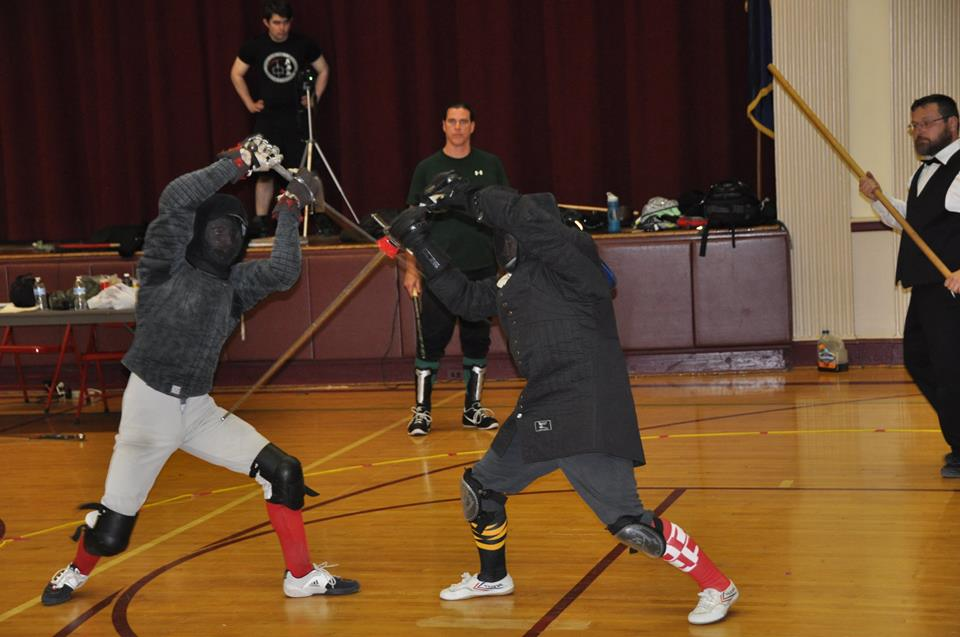 Redlands Fencing Academy's Dustin Regan (left) takes on MKDF's John Crum (right) for third place. Photo by Brad Rangell.