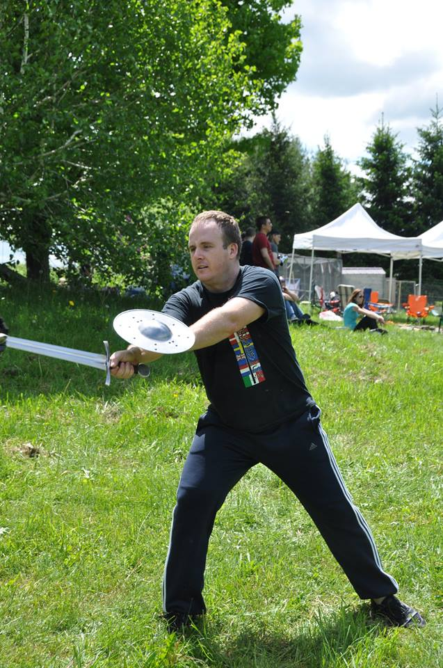 Triangle Sword Guild's Ben Strickling teaching I.33. Ben would later go on to take second in the open longsword. Photo by Brad Rangell.