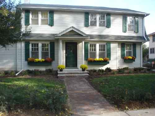 image-of-a-home-after-real-wood-shutters-were-installed-by-Headhouse-Square.jpg