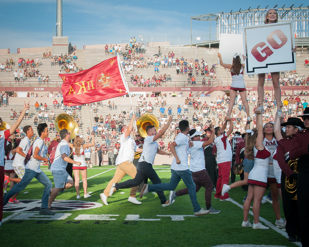 First year NMSU students take to the field at Aggie Memorial Stadium for the inaugural Aggie Ramble before the game against the Georgia State Panthers.