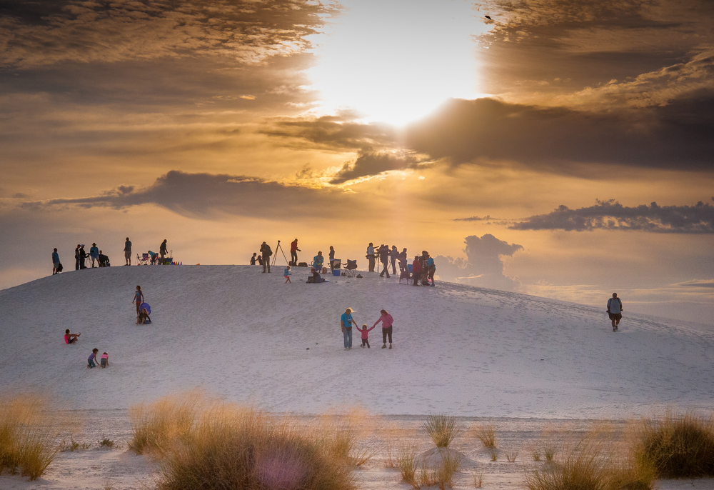 Spectators at the White Sands Balloon Invitational on Saturday at White Sands National Monument begin to leave after hearing that liftoff is cancelled due to high winds.
