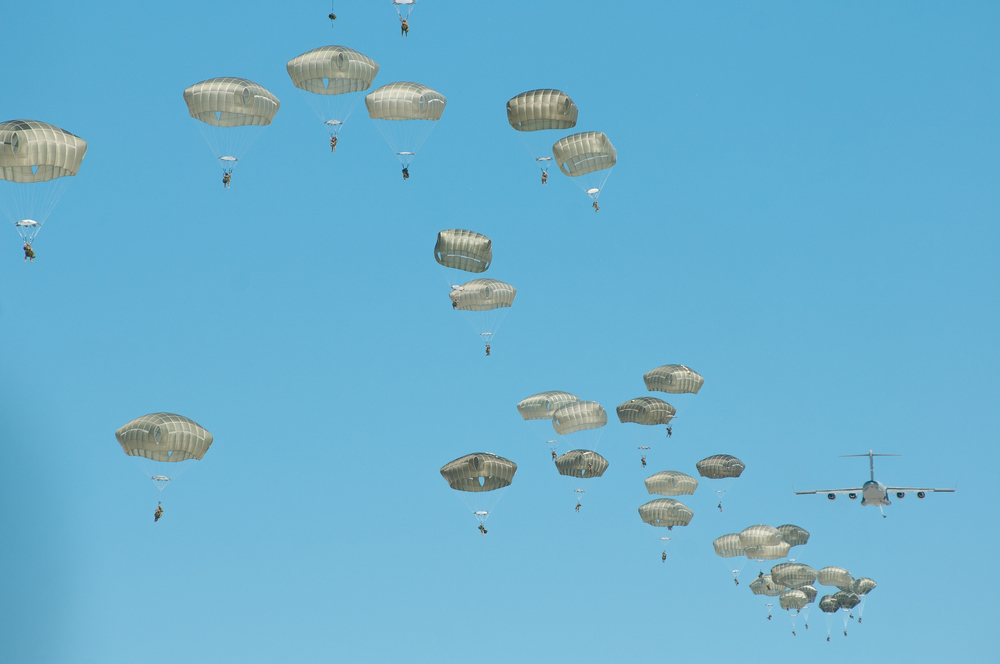 Soldiers from the 82nd Airborne Division jump from a C-17 aircraft as part of the U.S. military's Network Integration Evaluation at White Sands Missile Range's Space Harbor on Sunday. Approximately 600 jumped from 1,000 feet to to confront about 200 soldiers on the ground acting as enemy combatants.