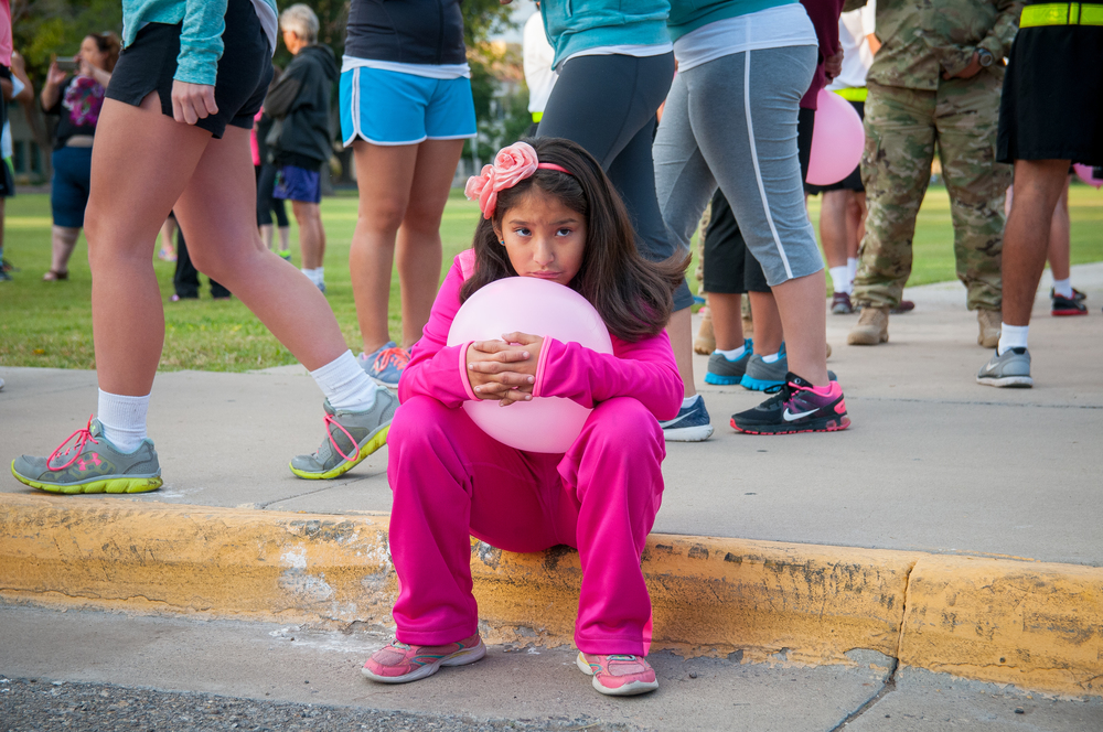 9-year-old Celestina Chaparro, who lost her grandmother to cancer two weeks ago, at the NMSU campus on Saturday morning during the Emma Jean Cervantes 5K/10K Run and Walk that helps supports cancer survivors and their loved ones.