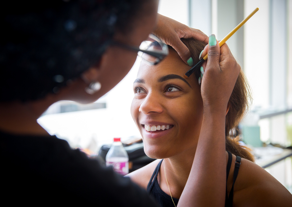Centennial High School senior Iyabo Adeogba has her make up done for free for the school's prom by El Paso-based freelance makeup artist Nicole Hector, April 16, 2016. Seniors and staff of Centennial had the opportunity to have their makeup done for free at the school, courtesy of High School Nation. The nonprofit organization, committed to advancing the arts in high schools, also provided free tuxedo rentals to the senior men as well as providing tents, a DJ and other amenities.