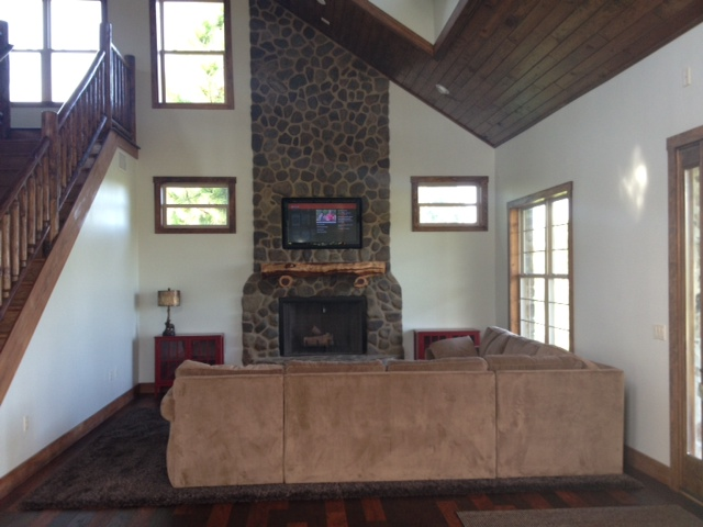 Ortiz – We designed and crafted a stunning custom fireplace as the focal point for this family's rustic family room, and included the high-tech comforts of home.  CGC Kilfoyle is a full-service masonry contractor.