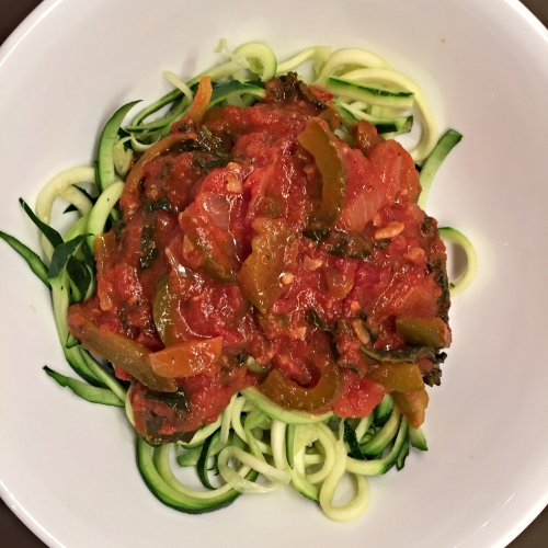 Voila! My beautiful zucchini pasta topped with a tomato marinara sauce with kale, green peppers, onions, garlic and of course some spicy chili peppers!