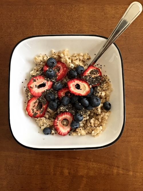 Steel cut oatmeal with chia seeds, blueberries and strawberries! You can't see the maple syrup but it's mixed in. YUM!