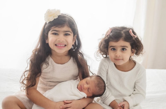 Lily & Olivia are the proudest big sisters to baby Armin. It's absolutely heart-melting.