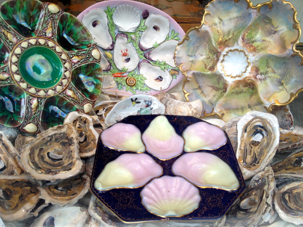 Antique oyster trays for sale in the French Quarter.