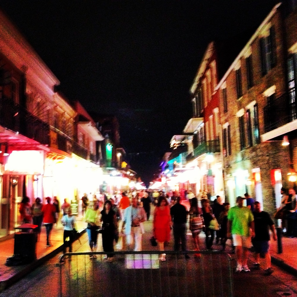 Blurry Bourbon Street at night.