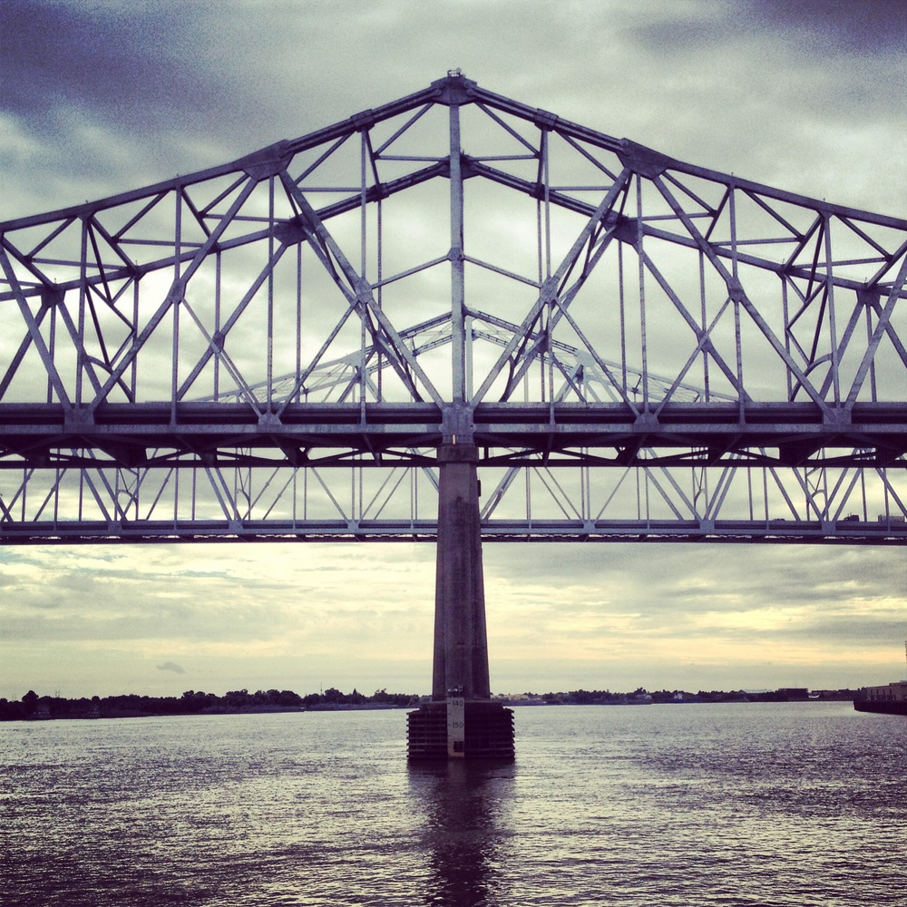 The Crescent City Connection is two cantilever bridges which connect Route 90 business over the Mississippi River in NOLA.