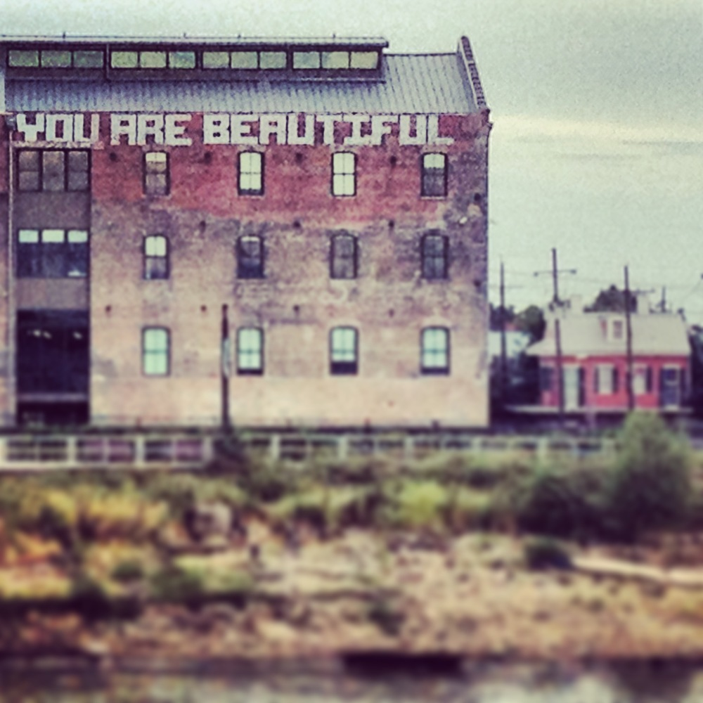 "New Orleans' Rice Mill Lofts in Bywater. ""You Are Beautiful"" is rumored to be a work of Banksy."
