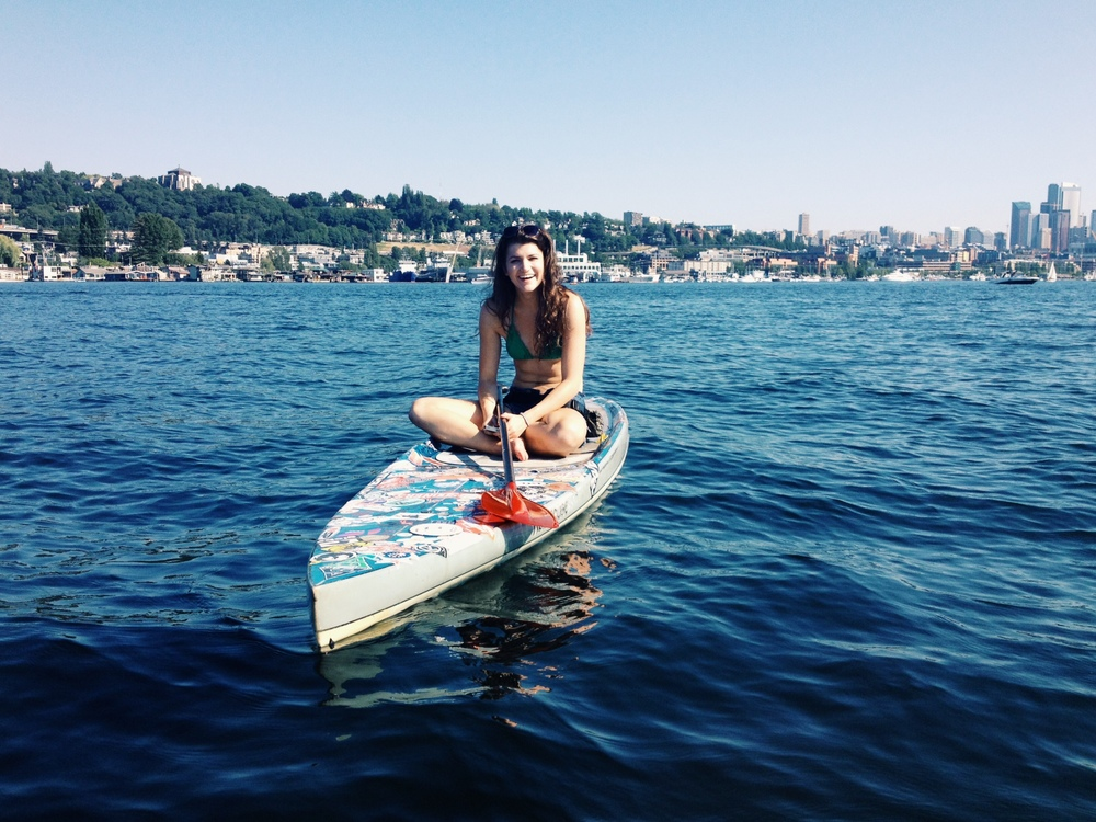 Allyce's friend Alexandria Korobkin paddleboarding on Lake Union