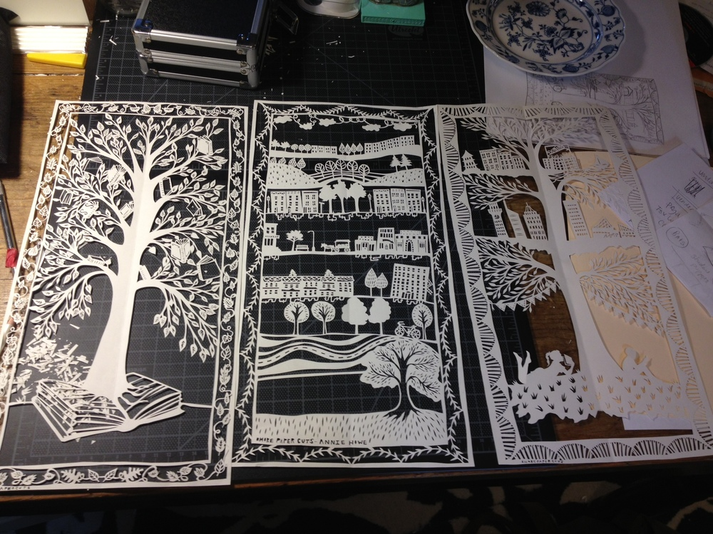 """Once I've cut everything out, I go back in and carefully neaten any edges and cuts that need polishing. Then I'm done! This project features three different panels. Each of them will be scanned, and those designs will be turned into printed banners."""