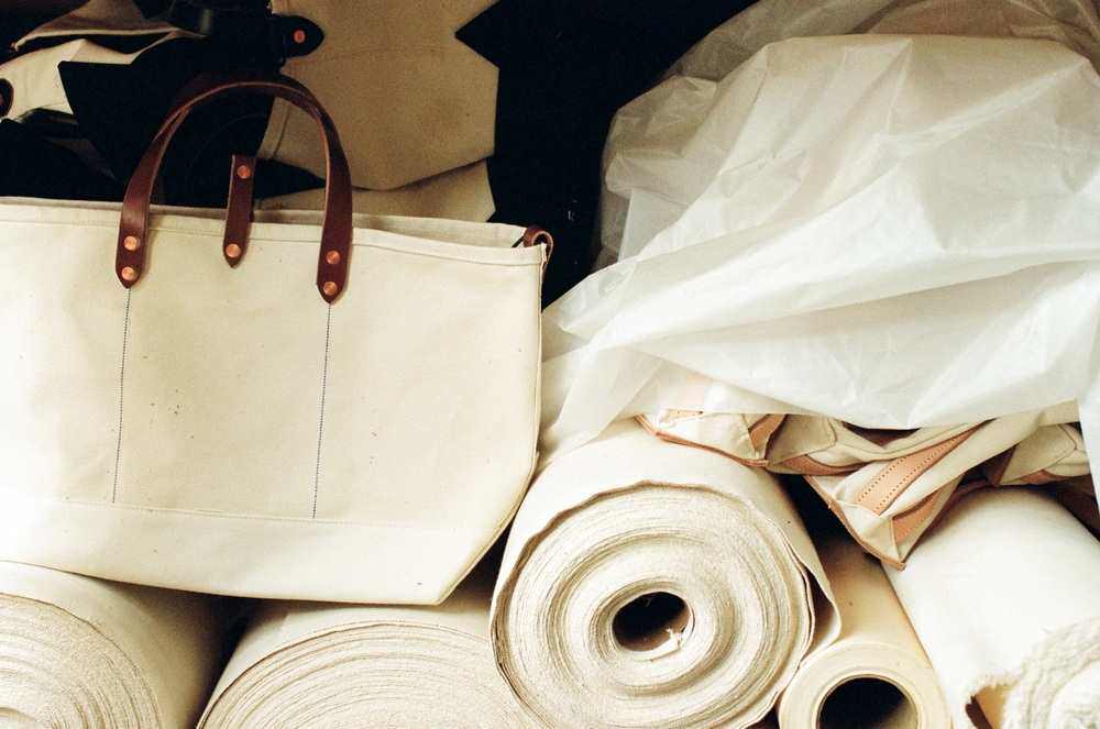 Joshu Vela white bag and fabrics. Cotton is grown by Texas organic cotton growers, milled in SC and sewn in SF.
