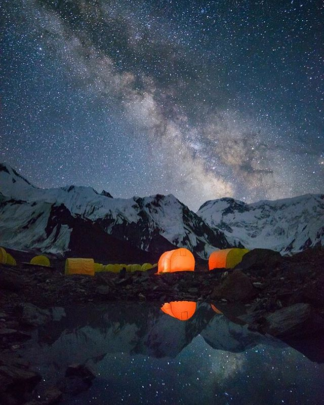 """The Milky Way rises over 7,439m Pobeda Peak, the highest in the Tien Shan mountains and farthest north 7,000m peak on the planet. Clear and cold temperatures were perfect for night photography at Khan Tengri/Pobeda Basecamp."" 👉 by @dodrillphoto"