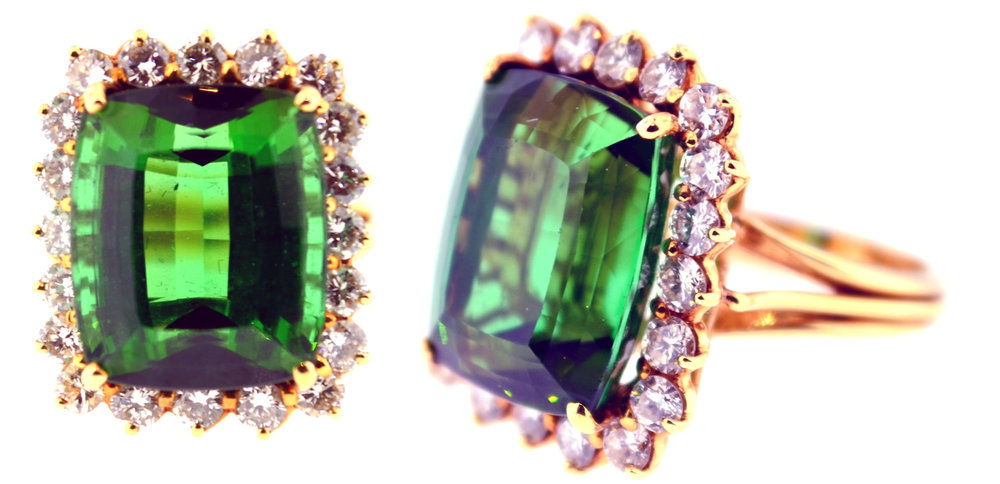 MSP43, 14 karat yellow gold mounting, set with a 14.5 carat green tourmaline, surrounded by 1.05 carats of diamonds. Retro, circa 1970.