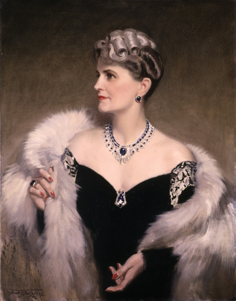 Portrait of Marjorie Merriweather Post in 1946 by Frank O. Salisbury, featuring a necklace set with an exquisite 58.33 carat cushion-cut kashmir blue sapphire, which was originally gifted to Marjorie from Hutton in 1920 and set in a bracelet by Cartier. Like most of her jewelry from this time, the stone has been mounted and remounted, coinciding with different decades and marriages and was actually realized as a convertible, which can be taken out of the bracelet and set in this necklace as well as another ring designed by Harry Winston in the 1950's.