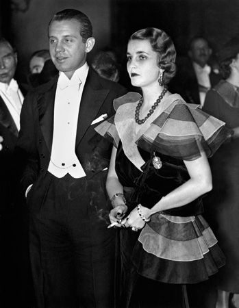 Barbara Hutton and her first husband, Alexis Mdivani, 1933. Her spending at this time was out of control and made headlines during the depression, her family even offered a dowery to Alexis of $1 million, and their marriage only lasted a year. Hutton is wearing the infamous Hutton-Mdivani commissioned Jadeite bead and ruby necklace by Cartier which sold at auction in 2014 for over $27 million!