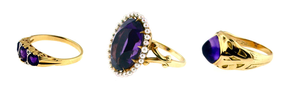 Left: An Edwardian saddle ring, set with 3 amethysts and rose-cut diamonds. Center:  A Victorian Revival dinner ring, set with a large oval amethyst and surrounded by natural pearls.  Right:  An Arts & Crafts 14 karat gold band with beautiful engraving and a pyramidal cabochon amethyst. c. 1900