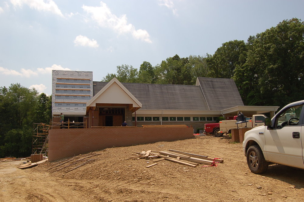 Front entrance takes shape. Brick work nears completion.